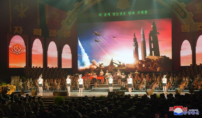 A more familiar North Korean musical performance, for participants of the 8th Munitions Industry Conference in Pyongyang last December.