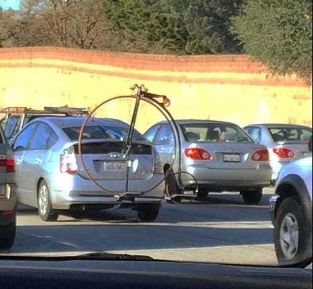 First, there's this penny farthing hitched on a Prius: