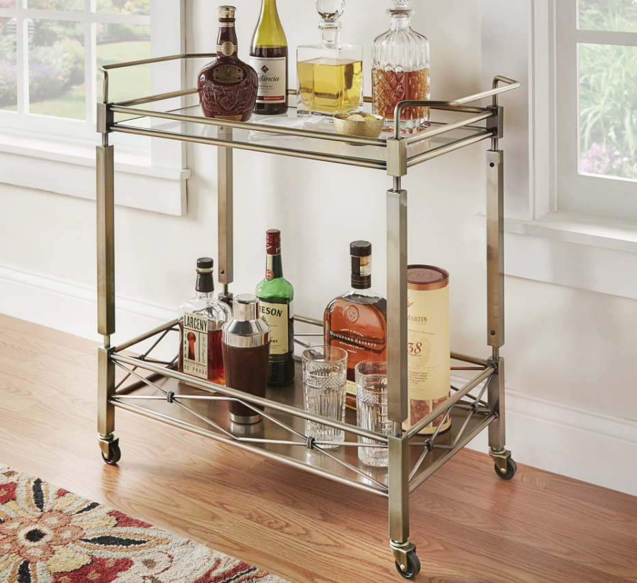 """Promising review: """"I've been searching for the right bar cart for more than a year because I'm very picky. I found this and thought it would be the right color to compliment the decor in my dining room. It arrives in one large box and you have to screw on the wheels, the four legs, and the top. The tempered glass is boxed separately, and you'll have to place it on top once you have assembled the bar. It rolls without any issue and it's big enough to place a lot of things on it."""" —OstkUser24791169Price: $192.99"""