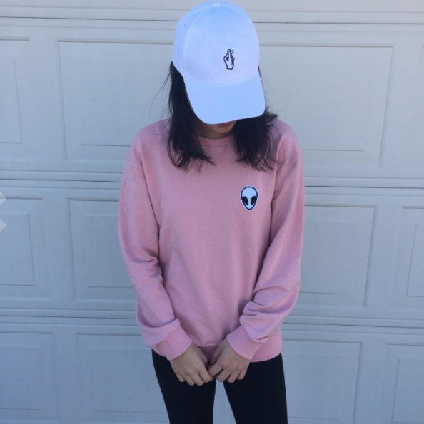 "Promising review: ""The pink color is very cute and the color is the same as what's shown in the photo. I love the alien patch on it! The fabric is stretchy and comfy. I would say go a size up if you want the sweatshirt to fully cover your bottom. I'm 5'3"" and I purchased a size small."" —Airaj V 