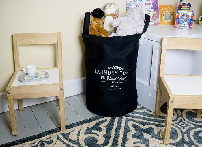"It says ""Laundry Today or Naked Tomorrow,"" which will be you if you decided to lean into your laziness. Promising review: ""I love it! It is a tough bag that can hold lots of clothes. I live in a five-story apartment complex, so I have to take my clothing to the laundry room. I can't walk very far so I ride an electric scooter for the handicapped. The handles on this bag make my trips to the laundry much, much easier!"" —Kathryn J. Isler Get it from Amazon for $18.97 (available in two colors)."