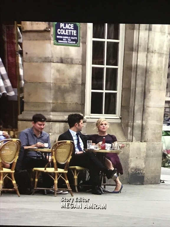 When Ben and Leslie go to Paris, they have lunch right next to Mose from The Office.