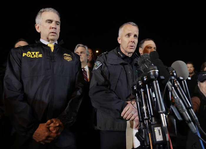 Interim Austin Police Chief Brian Manley (right) briefs the media on March 21 in Round Rock, Texas.