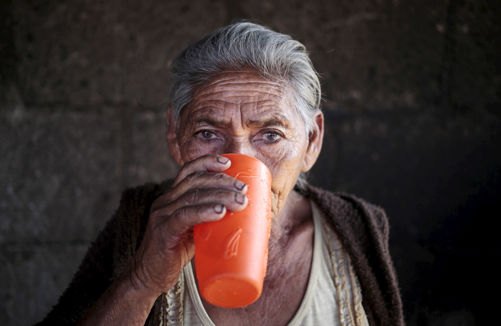 A woman drinks water in El Crucero town, Nicaragua, on Feb. 27, 2016. Some 650 million people, or one in 10 of the world's population, have no access to safe water, putting them at risk of infectious diseases and premature death.