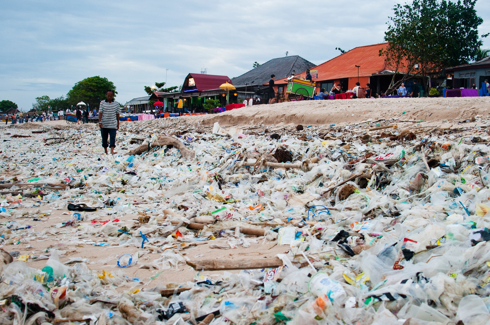 Local residents observed to see piles of garbage on January 17, 2018 at Kedonganan beach, Bali, Indonesia. (Photo by Muhammad Fauzy/NurPhoto via Getty Images)