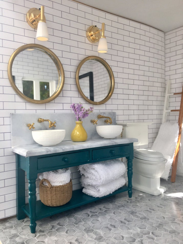 """That's more photo paper on the walls and floor,"" she said. ""I made the mirror from jump rings I spray painted, and I made the shower door out of craft wood and Plexiglas from Home Depot."""