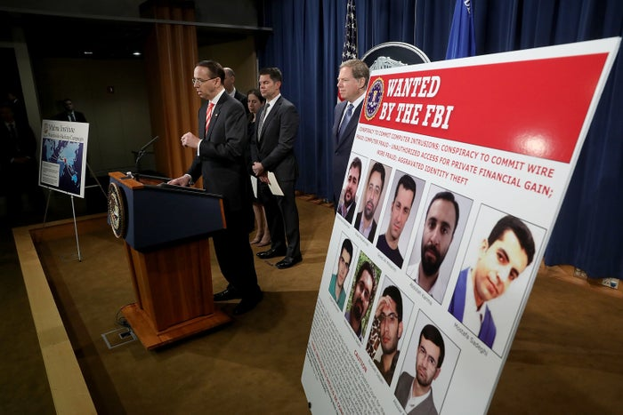 Deputy Attorney General Rod Rosenstein announcing charges against nine Iranians.