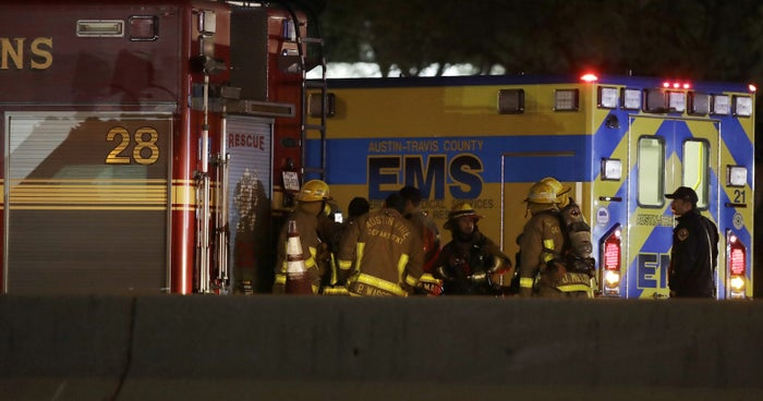 Firefighters stage near the area where a suspect in a series of bombing attacks in Austin blew himself up early March 21.