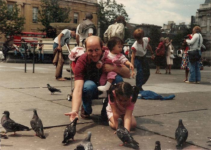 Doing some (now forbidden) pigeon-feeding in London with my father and sister.