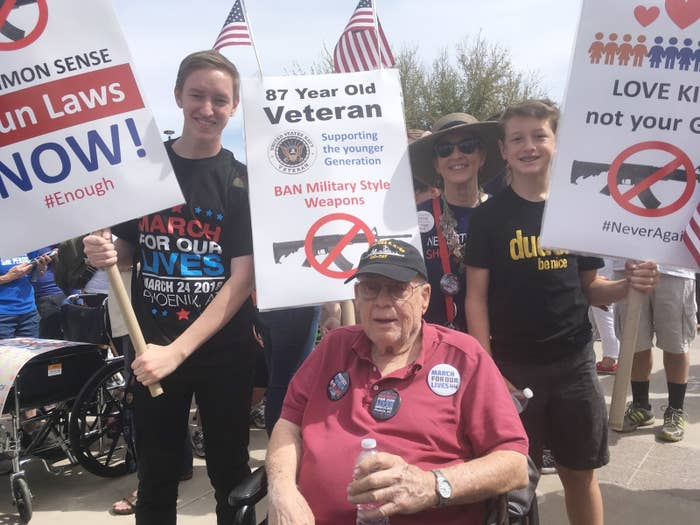 Among the thousands of marchers in Phoenix, Korean War veteran Donald Fouts, 87, joined in a wheelchair decorated with American flags.