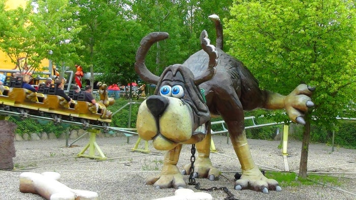 "The name of this Danish amusement park ride translates to ""Dog-Fart Roller Coaster"". Rolling with the theme is the coaster trains, which are designed in the shape of a dog named ""Henry Dog Fart"". The ride itself will take you round piles of dog faeces and a statue of Henry caught mid-poop. How lovely."
