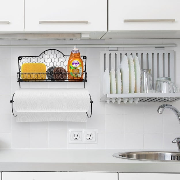 A cute paper towel holder nestled below a convenient shelf for other frequently used kitchen items, like dish soap and sponges.