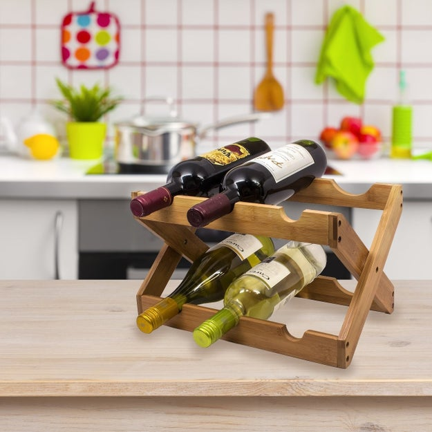 A charming foldable bamboo wine rack to prove to your guests that you've got this whole adulting thing down pat.
