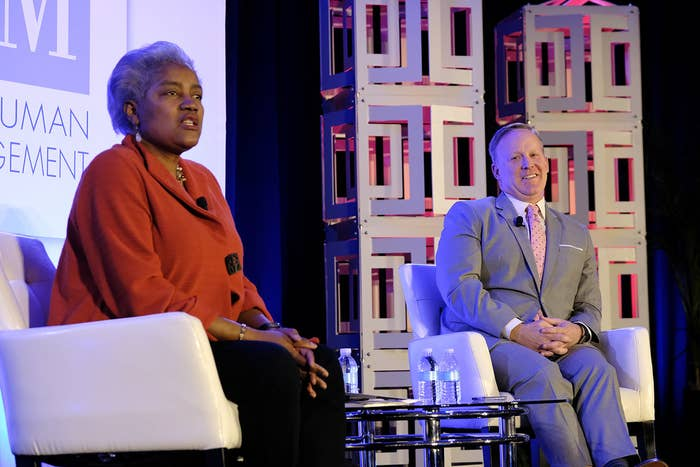 Donna Brazile and Sean Spicer speak to the crowd of HR professionals.