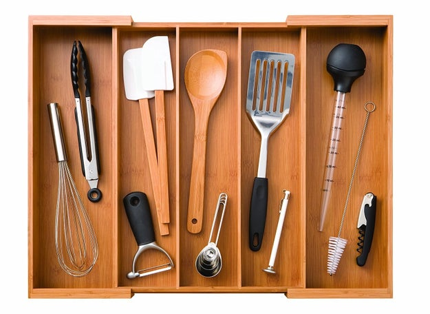 A gorgeous expandable bamboo cutlery drawer so you'll never have to dig through a pile of utensils again just to find that dang spatula again.