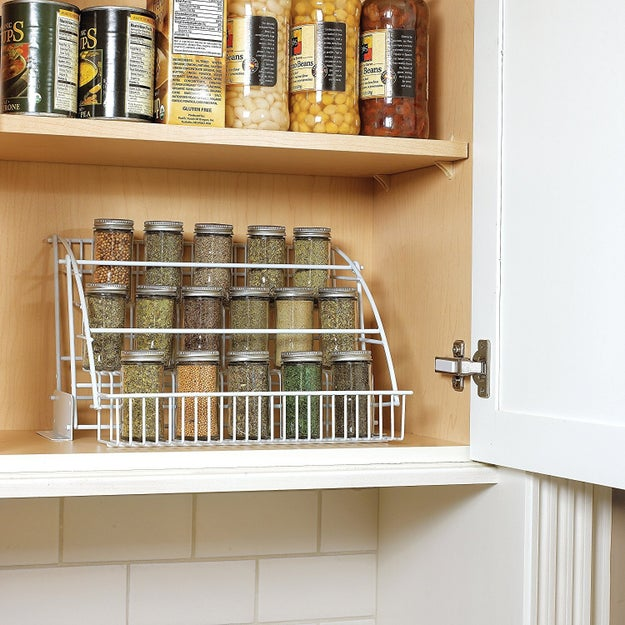 Or a pull-down spice rack that makes use of vertical space and can also be used to organize all sorts of goods housed in small containers.