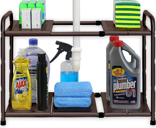 An expandable shelf to organize all that crap you've got strewn about like a tornado hit under your sink.