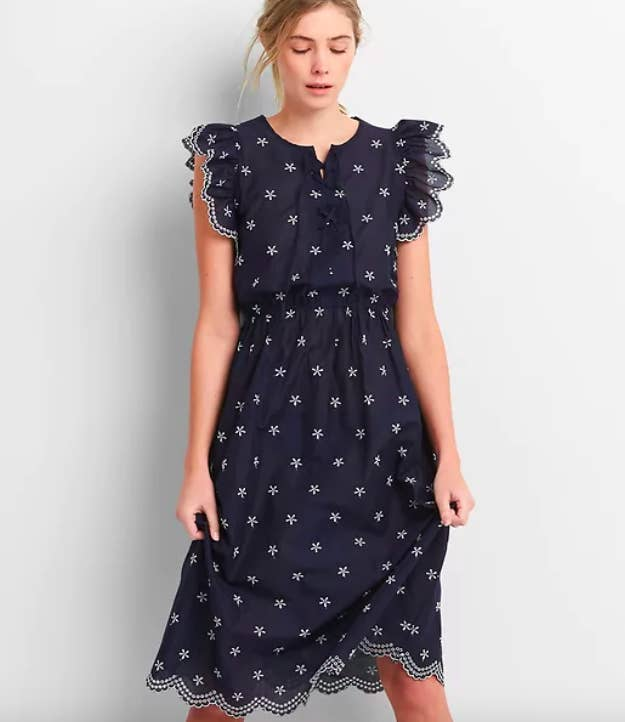 e94aaeb852a1b0 A 100% cotton ruffled-trim eyelet dress you ll quickly learn to rely on  when you can t figure exactly what the weather calls for.
