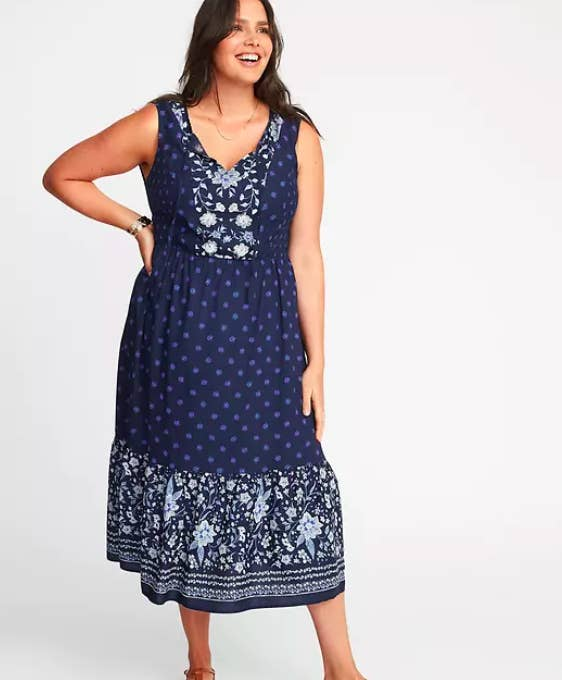5e0d54d5891 A floral-print fit-and-flare midi dress that ll can easily be thrown on  when you just don t want to f  %ing think about it. Get it from Old Navy ...