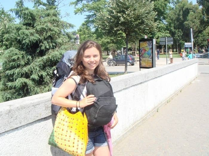 Katie, age 18, on her first solo backpacking trip in Tirana, Albania.