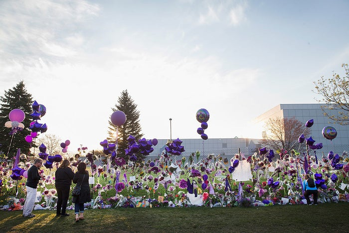 Prince fans visit a memorial created outside Paisley Park, the home and studio of the music artist, April 23, 2016.