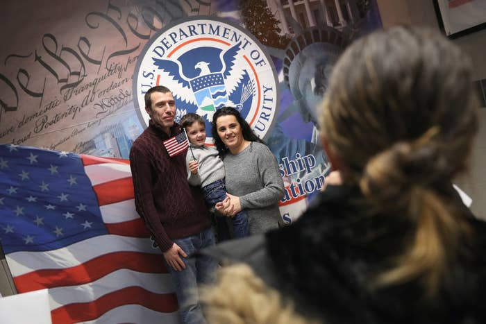 A family celebrates US citizenship following a naturalization ceremony in New York.