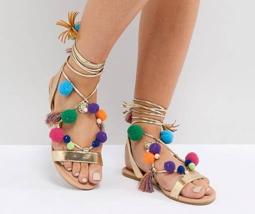 16c5ecfc590 An eye-catching pair of sandals guaranteed to win you best dressed while  you re hanging by the pool.