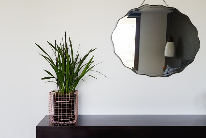 Not only do mirrors give the illusion of more space, but they also bounce light around a room. Increase your natural light by hanging a mirror directly across from a window. You could also hang two mirrors across the room from each other to really bounce light around your space. Or, if you've been #blessed with two windows in the same room, hang a mirror in between them to act as a third window and maximize brightness.