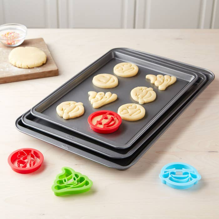 """It comes with three cookie sheets and four cookie cutters.Promising review: """"I love these cookie cutters!! My kids love to make emoji cookies and treats! We've used the pans a few times and they are super easy to clean! No need to put them in the dishwasher because food just slips right off."""" —afm55Get the set from the Tasty collection at Walmart for $9.97."""