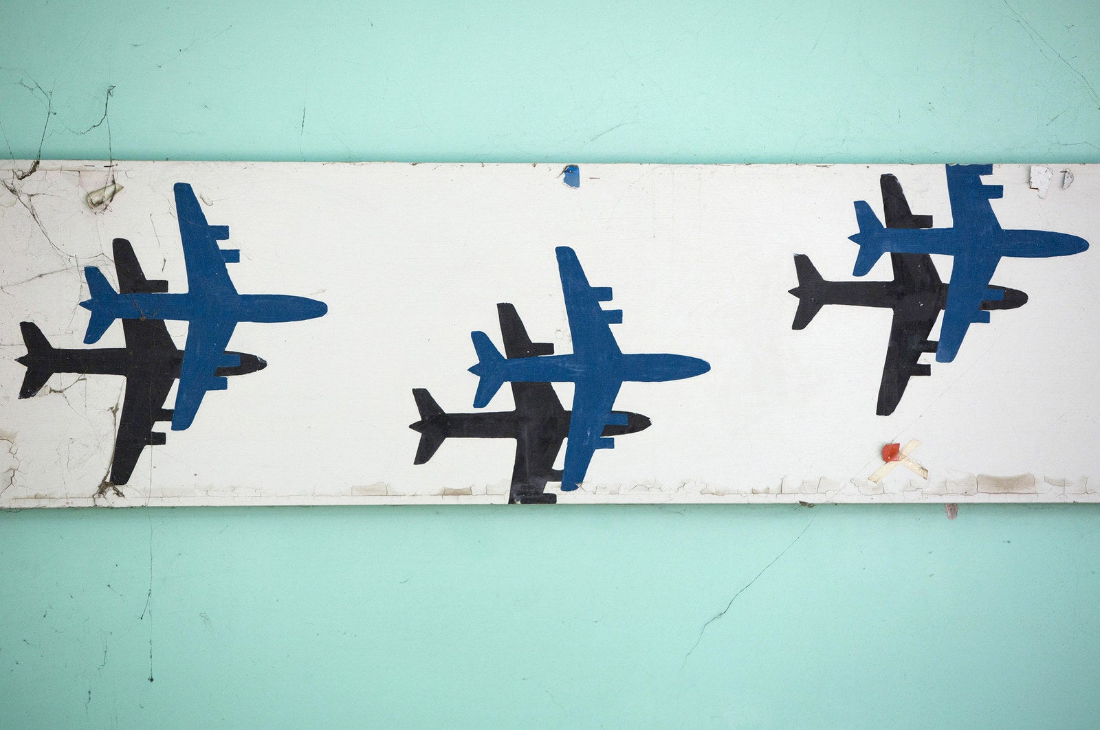Images of airplanes decorate a wall.