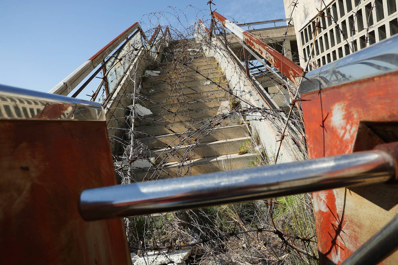 A stairway covered in barbed wire leads to the former visitors restaurant and terrace.
