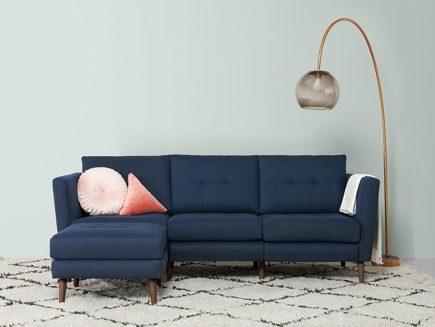 Styles: They just make the one, The Burrow, which can be customized with your selection of fabric, size, and arm height. The sofa is chemical-free, stain-resistant, and has a hidden USB charging port.Prices: $495+Shipping: Shipping fees are already included in the cost of the sofa. The sofa arrives in lightweight boxes, and a simple, tool-free, assembly is required. Get the Burrow Sofa for $1195+ (available in a variety of fabrics and finishes).