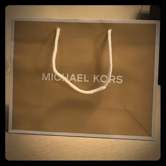 Yes, as in the bag they give you when you shop at a designer store. Like Michael Kors, for example.