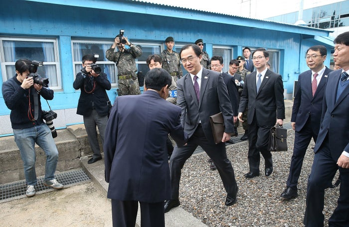 South Korean Unification Minister Cho Myoung-gyun (centre) crosses the Korean border line to attend high-level talks at the border village of Panmunjom on Thursday.