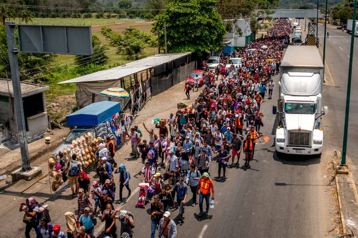 Migrants cheer after clearing the first immigration checkpoint in Chiapas.