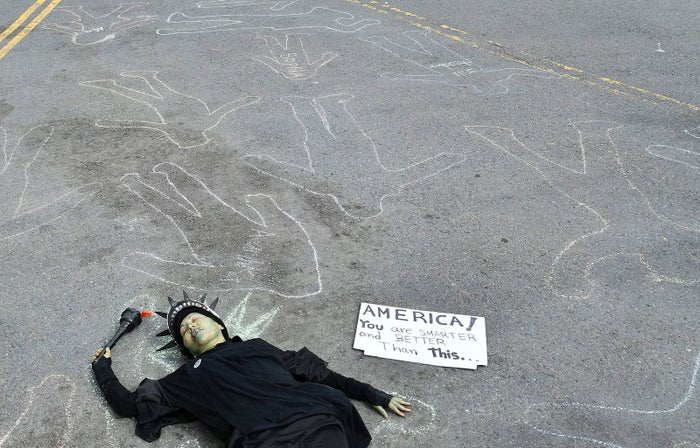Rosa Plume lies on the street as crowds of people participate in the March for Our Lives rally in support of gun control, in San Francisco on March 24.