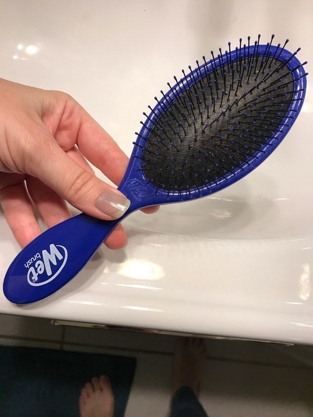 """""""My friend told me about it last weekend, so I grabbed one. It's an absolute miracle brush. This sucker slides right through my hair, wet or dry. My son likes it too."""" —shannonm49e341999Get it from Amazon for $7.98+ (available in 12 colors) or Walmart for $8.05."""