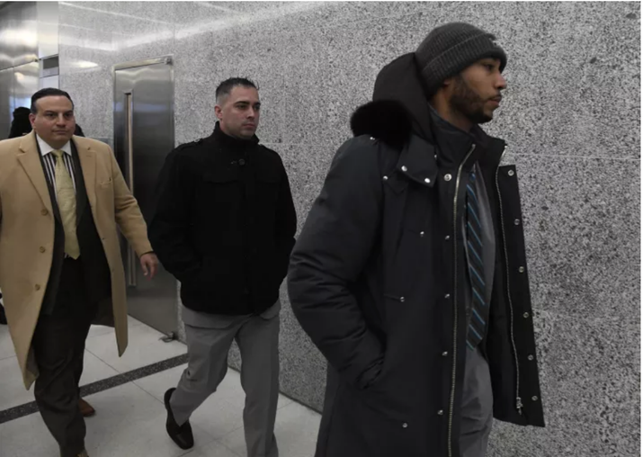 Former NYPD detectives Eddie Martins (center) and Richard Hall (right) leaving court in January.