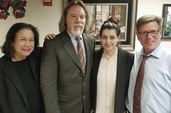 Noor Salman, second from right, and her attorneys pose for a photo after Salman was acquitted.