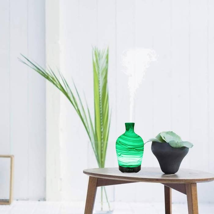 """Promising review: """"I absolutely love this glass diffuser! It goes perfectly with the decor/colors of my house. It's a perfect size for any spot. The stream is very effective. I currently have it downstairs in my kitchen and I walked out of my master bedroom (upstairs) and could smell it right away. The colors are awesome. My 2-year-old already loves it and has fun naming each color as it was on the rotation. When I'm ready for a second one or to give one as a gift, I'll definitely be getting another one of these!"""" —Morgan VanDerLeestGet it from Amazon for $31.99+ (available in four styles)."""