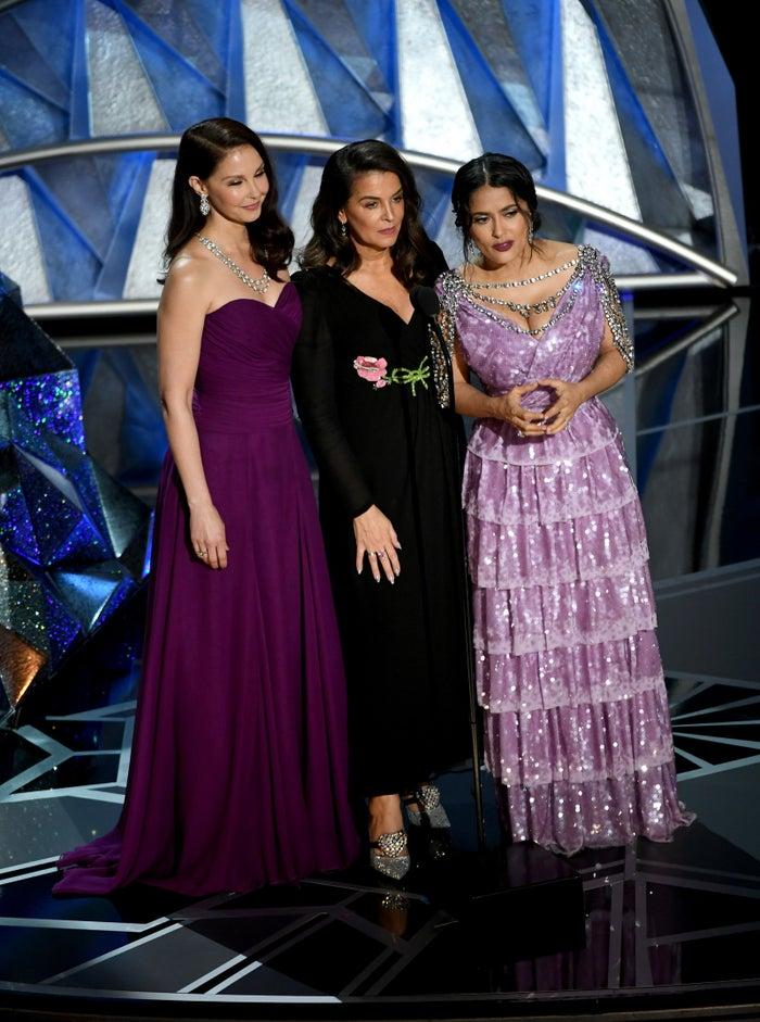 Actors Ashley Judd, Annabella Sciorra, and Salma Hayek speak onstage during the Academy Awards.