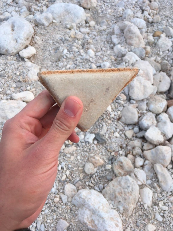 This rock that looks like a crustless sandwich cut with the utmost precision.