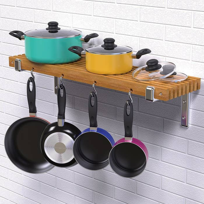 "Includes: 1-quart pot with lid and long handle, sauté pan and long handle, 1.3-quart pot with lid and long handle, 1.75-quart pot with lid and short handle, 4.2-quart pot with lid and short handle, frying pan with long handle, slotted spoon, slotted spatula, spaghetti server, soup ladle, and a potato masher (15 pieces total).Promising review: ""Fantastic quality and value for a nonstick set. Not flimsy thin, but rather a nice weight to them. The handles are comfortable and glass lids are sturdy with a good fit. Such decent quality for a starter set that will last a while. I'm a cookware snob using top-of-the-line Calphalon and All-Clad and I thought this set was great."" —Emily P. Get it from Amazon for $44.99+ (available in multicolor and all-black).What's that? You're looking for more ways to save space in your tiny kitchen? Check out some other suggestions here."