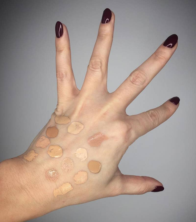 Hand with various makeup foundation