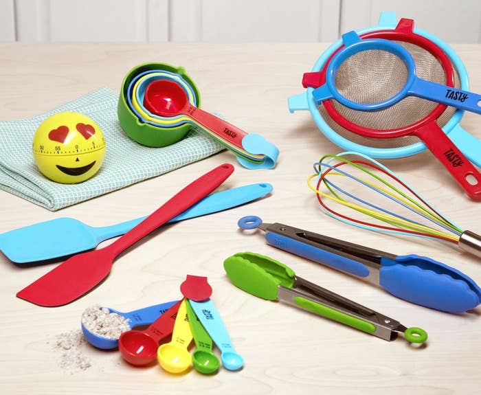 """The set includes:-emoji timer -10-piece measuring spoon and cup set -two 12"""" silicone spatulas-whisk -two tongs (7"""" and 9"""") -three-piece strainer set Get it from the Tasty collection at Walmart for $39.76."""