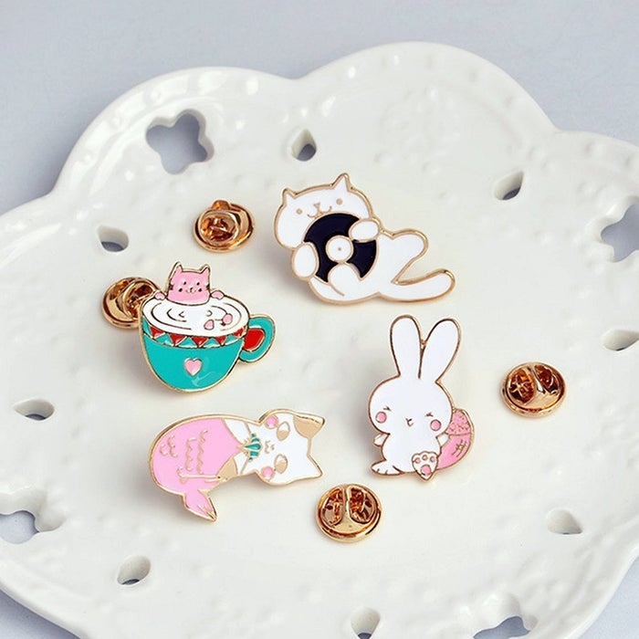 "Promising review: ""Super adorable set, came with a couple extra backs (!) and even got here in time. Pins like these have become more popular among my daughter's friends, and this set was too adorable to pass up."" —CF6Get a set of four from Amazon for $9.49."