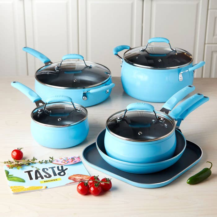 """Set includes 9.5"""" fry pan, 11"""" griddle pan, 1.5 qt. saucepan with glass lid, 2.5 qt. saucepan with glass lid, 4 qt. deep cooker with glass lid & helper handle, 6 qt. Dutch oven with glass lid, and a recipe booklet. This set is dishwasher-safe!Get it from the Tasty collection at Walmart for $99 (available in three colors)."""