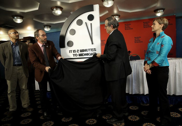 """Lawrence Krauss (second from left) unveiling the Bulletin of the Atomic Scientists' 2018 """"Doomsday Clock."""""""