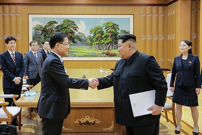 Chung Eui-yong (left), head of South Korea's presidential National Security Office, shakes hands with Kim Jong Un at their meeting in North Korea.