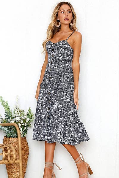 f036fd780b7 A button-front midi dress with an itty-bitty print but major style (not to  mention a couple of roomy pockets).